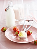 Vanilla ice cream, strawberries and milk for milkshake