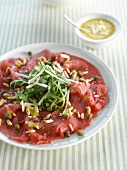 Beef carpaccio with pine nuts and capers