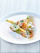Tea broth with king prawns and spring vegetables