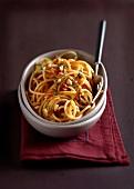 Spaghettis tomato pesto and pine nuts