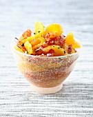 Orange fruit salad with mild onions, pistachios and argan oil