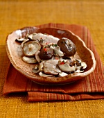 Guinea-fowl fillet with garlic shiitakes and button mushrooms
