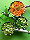 Saucepans of different vegetables