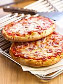 Ham-cheese pizzas