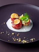 Scallops wrapped in smoked duck breasts