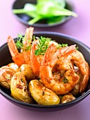 Shrimps and potatoes sauteed with honey