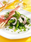 Raw ham with bread sticks and green vegetable salad