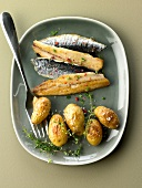 Fried sardines with small roasted potatoes