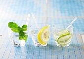 Glasses of lemonade with mint,lemon and lime