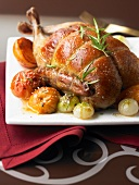 Roast duckling with apricots,small onions and rosemary