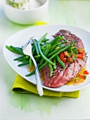 Grilled beef steak with steamed green beans