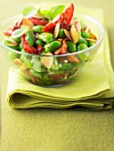 Broad bean salad with thinly sliced almond and sun-dried tomatoes