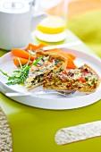 Slice of spinach tart and tomato-broccoli tart