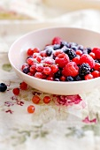 Mixed summer fruit with sugar