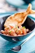 Salmon ceviche and a fish-shaped bread