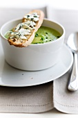 Cream of zucchini soup with Roquefort on toast