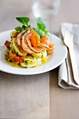 Potato and tomato salad with herbs and salmon gravlax, cream curry sauce