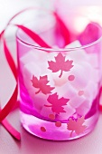 Sugar lumps in a decorated pink glass