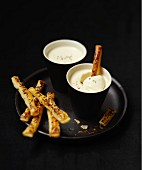 Goat's cheese dip with poppyseed flaky pastry sticks