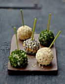 Three-flavored goat's cheese bites on sticks