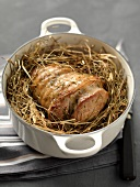 Saddle of lamb in hay