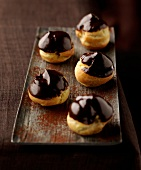 Puff pastries coated in dark chocolate