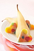Multicolored jelly fruit hearts with poached pears