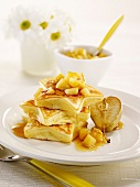 Star-shaped pancakes with diced pears and maple syrup