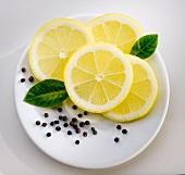 Slices of lemon,peppercorns and bay leaves
