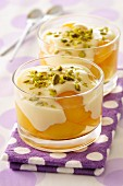 Peaches with vanilla cream dessert and pistachios