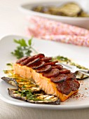 Salmon coated with sliced Chorizo