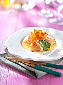 Pan-fried scallops with foamy saffron sauce and pumpkin crisps
