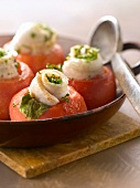 Tomatoes topped with rolled sole fillets