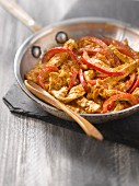 Sauteed turkey with red bell peppers and paprika
