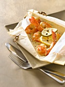 Gambas with cream, ginger and green pepper cooked in wax paper