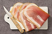 Slices of raw ham on a chopping board