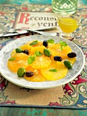 Orange fruit salad with green and black olives