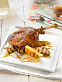 Duck confit with apples and orange zests