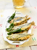 Fried anchovies stuffed with peppers