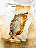 Bass with vegetables cooked in wax paper