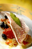 Sea bream fillet with tomatoes and olives