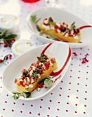 Polenta with tomatoes,mozzarella,capers and anchovies