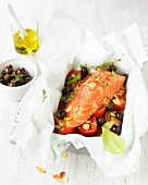 Salmon,cherry tomatoes and black olives cooked in wax paper