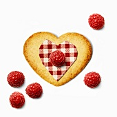 Heart-shaped cookie with raspberries