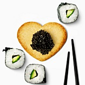 Heart-shaped biscuit ,fish roe and makis