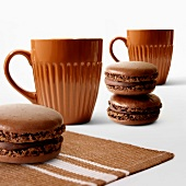 Chocolate macaroons and two cups