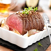 Roast wild boar with beer and garlic