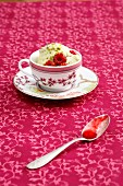 Roasted pistachio ice cream with raspberries