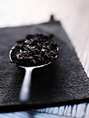 Tea leaves on a spoon