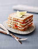 Smoked salmon and cream cheese club sandwiches with lime